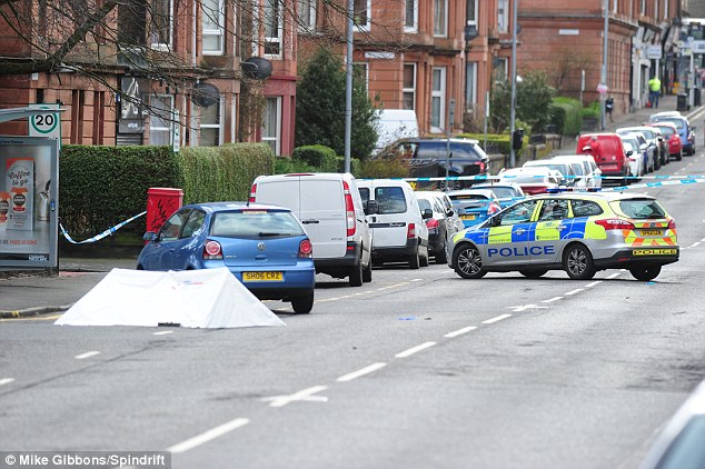 Witnesses say the victim was stabbed and then stamped on before his attackers ran off