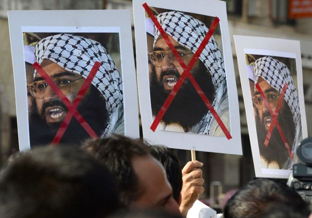 Indian activists carry placards of Masood Azhar during a protest against the attack at Pathankot