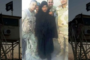 SIS-fighter-is-paraded-by-Egyptian-soldiers-after-disguising-himself-as-a-burka-clad-WOMAN