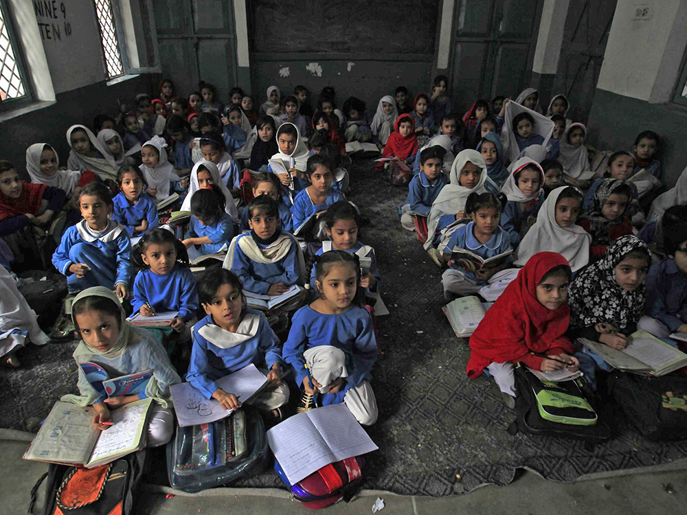 Girls attend their daily class at a government school in Peshawar October 29, 2014.