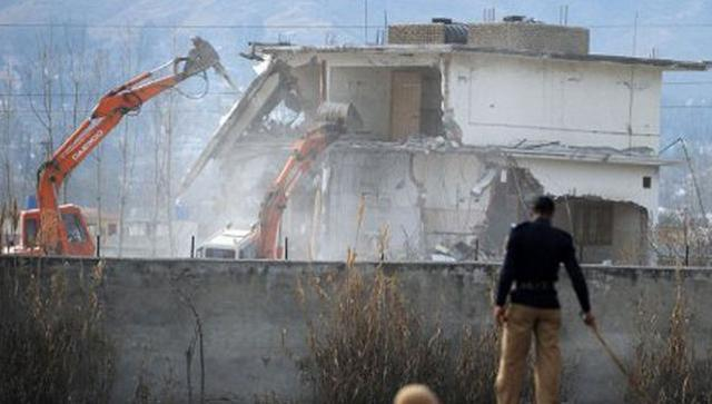 In this file photo, a Pakistani policeman stands guard as security personnel conduct demolition works on the compound where al Qaeda chief Osama bin Laden was killed. (File Photo)