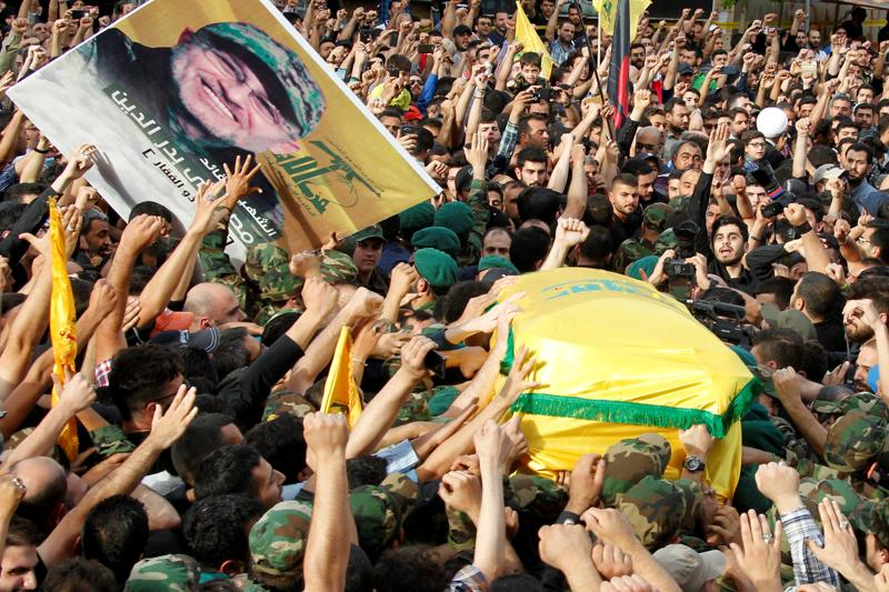 Hezbollah members carry the coffin and a picture of Badreddine. (REUTERS)
