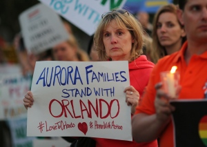 Anita Busch, who says her cousin was killed in the mass shooting in Aurora, Colorado, attends a vigil following last week's shooting in Orlando. (David McNew/Reuters)