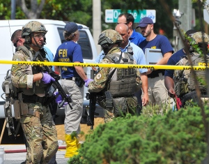 FBI and state police investigate the attack at the Pulse nightclub in Orlando Fla. The shooting has invigorated public calls for the banning of high-powered assault rifles like the AR-15. (The Associated Press)