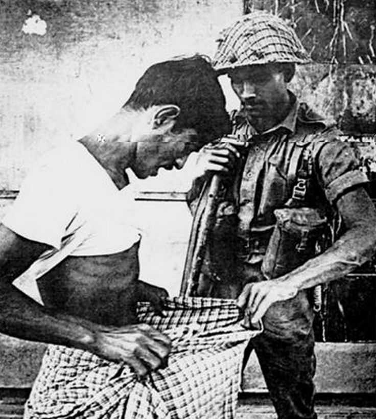 A Pakistani soldier examines whether a man is circumcised or not during Bangladesh's war of independence, 1971