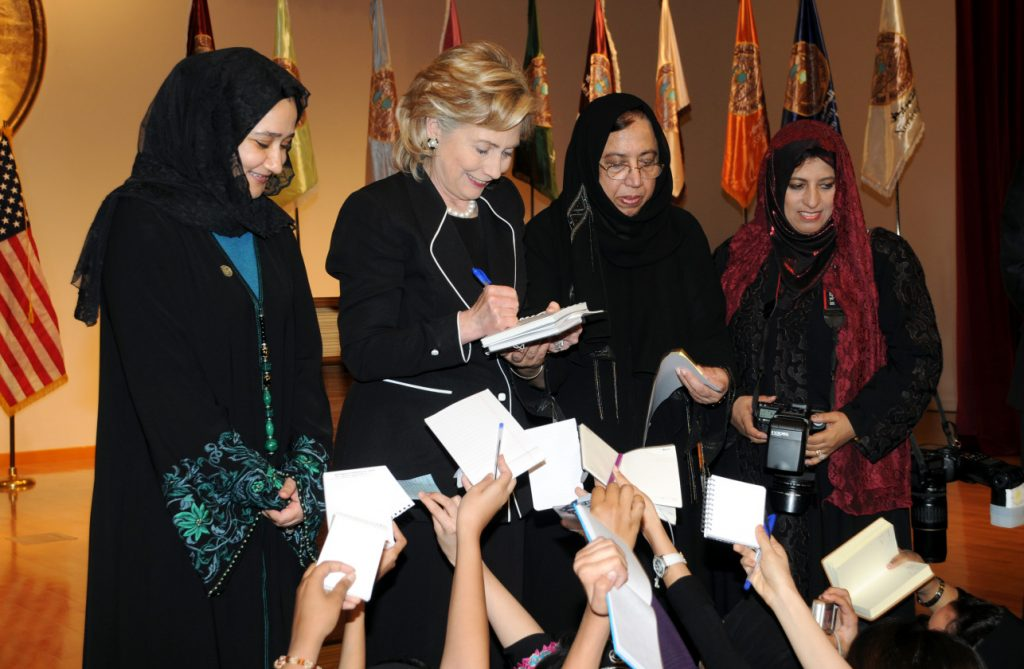 "Hillary Clinton at the Dar al-Hekma college for women during a ""town hall"" meeting in the Red Sea port city of Jeddah in 2010. Abedin's mother, Dr. Saleha Mahmood Abedin, is on Clinton's right."