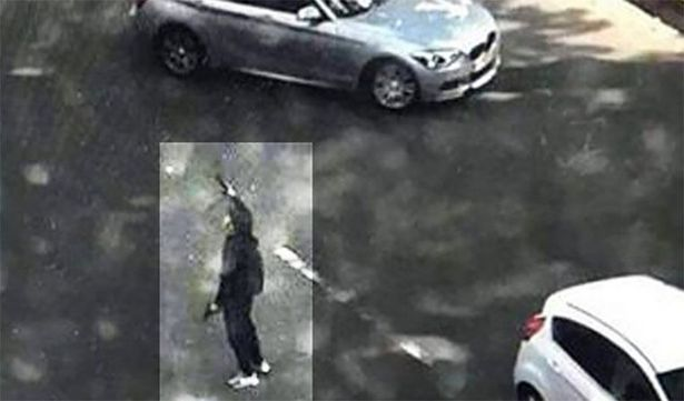 The gunman carries two handguns after killing his victims (Image: Twitter)